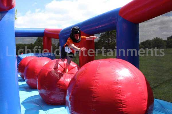 Big Jumping Balls inflatable obstacle course for hire.