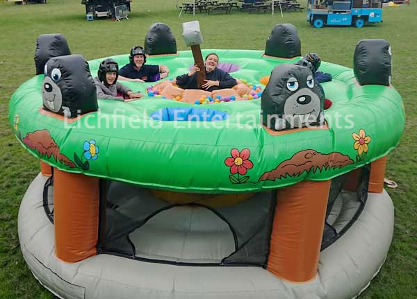 Inflatable Human Whack a Mole game for hire from Lichfield Entertainments