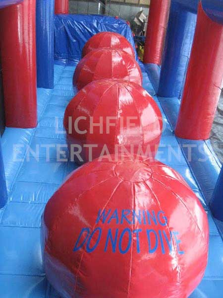 Giant Inflatable Balls - inflatable jumping game for hire. Can you make it across the four balls without falling?